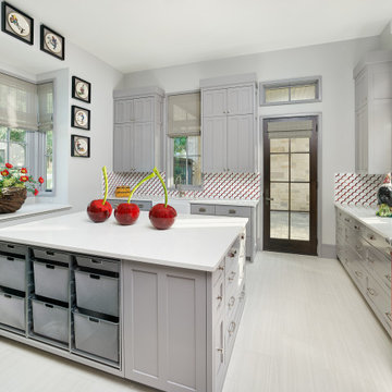 Multi-Purpose Laundry Room with Red Refrigerator and Island