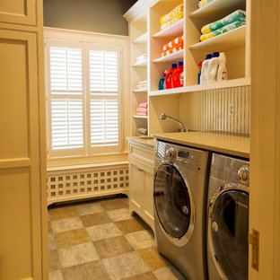 Inspiration for a timeless single-wall dedicated laundry room remodel in New York with open cabinets, beige cabinets, beige walls, a side-by-side washer/dryer and beige countertops