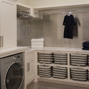 Photo of a large beach style l-shaped separated utility room in New York with open cabinets, white cabinets, composite countertops, white walls, porcelain flooring, a side by side washer and dryer and a submerged sink.