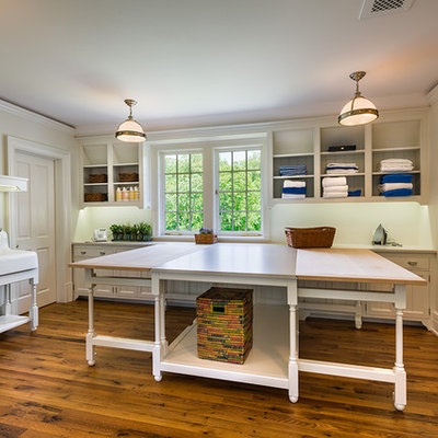 Inspiration for a large timeless l-shaped dark wood floor and brown floor dedicated laundry room remodel in Philadelphia with beige cabinets, an utility sink, shaker cabinets, wood countertops, beige walls, a side-by-side washer/dryer and beige countertops