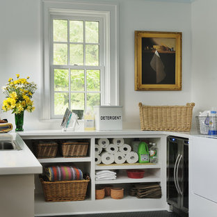 Design ideas for a traditional utility room in New York with open cabinets, white cabinets, white walls, black floors and white worktops.