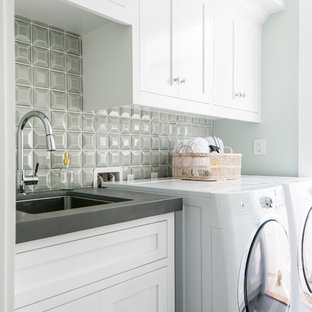 Design ideas for a mid-sized beach style dedicated laundry room in Orange County with an undermount sink, shaker cabinets, white cabinets, concrete benchtops, porcelain floors, a side-by-side washer and dryer, grey floor, grey benchtop and grey walls.