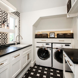 Inspiration for a large traditional separated utility room in Dallas with a built-in sink, white cabinets, soapstone worktops, porcelain flooring, a side by side washer and dryer, multi-coloured floors, black worktops, shaker cabinets and multi-coloured walls.