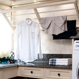 Photo of a traditional laundry room in Toronto with beige cabinets, recessed-panel cabinets and black benchtop.
