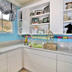 eclectic laundry room by Tina Kuhlmann