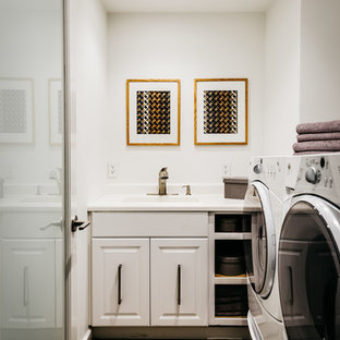 Dedicated laundry room - traditional single-wall dedicated laundry room idea in San Francisco with an integrated sink, raised-panel cabinets, white cabinets and white walls