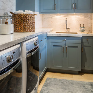 Example of a large classic single-wall ceramic tile and beige floor dedicated laundry room design in Other with an undermount sink, recessed-panel cabinets, turquoise cabinets, granite countertops, beige walls, a side-by-side washer/dryer and multicolored countertops