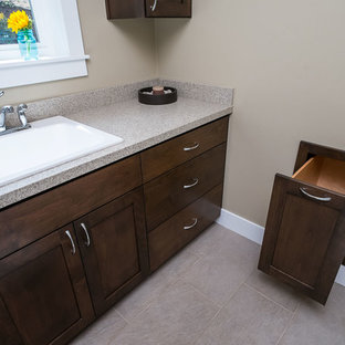 Dedicated laundry room - large modern medium tone wood floor dedicated laundry room idea in Portland with a drop-in sink, shaker cabinets, dark wood cabinets, quartz countertops, beige walls and a side-by-side washer/dryer