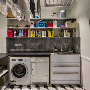 Inspiration for a large victorian porcelain tile dedicated laundry room remodel in Wellington with an utility sink, granite countertops, blue walls and a side-by-side washer/dryer