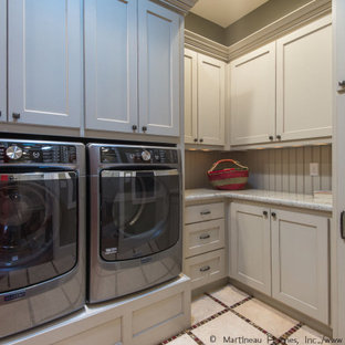 Inspiration for a large traditional laundry room in Salt Lake City with beige cabinets, beige splashback, beige walls, a side-by-side washer and dryer, beige benchtop and planked wall panelling.