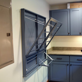 Example of a mountain style laundry room design in Charlotte