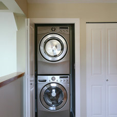 Contemporary Laundry Room by Odenza Homes Ltd