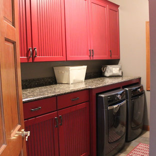 Dedicated laundry room - mid-sized transitional galley ceramic tile dedicated laundry room idea in St Louis with recessed-panel cabinets, red cabinets, quartz countertops, gray walls and a side-by-side washer/dryer