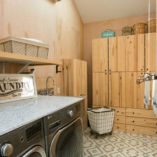 Cottage l-shaped white floor dedicated laundry room photo in Los Angeles with an utility sink, flat-panel cabinets, medium tone wood cabinets, brown walls, a side-by-side washer/dryer and white countertops