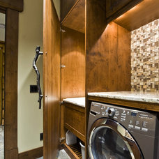 Rustic Laundry Room by Sticks and Stones Design Group inc.