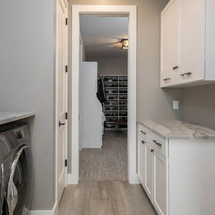 Inspiration for a mid-sized rustic galley light wood floor and beige floor dedicated laundry room remodel in Other with shaker cabinets, white cabinets, marble countertops, gray countertops and gray walls
