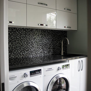 Inspiration for a small single-wall dedicated laundry room in Montreal with a drop-in sink, flat-panel cabinets, white cabinets, onyx benchtops, beige walls and a side-by-side washer and dryer.