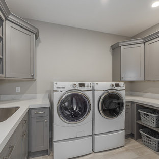 Dedicated laundry room - large craftsman u-shaped beige floor dedicated laundry room idea in Salt Lake City with an undermount sink, recessed-panel cabinets, gray cabinets and gray walls