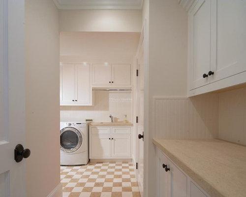 Beige stone floor laundry room design ideas renovations for Laundry room floor ideas