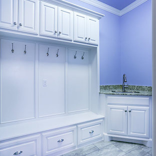 Photo of a large traditional galley utility room in Oklahoma City with white cabinets and purple walls.
