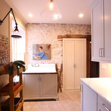 Pale Green Cabinets with Exposed Stone Wall and Timber Door Jamb