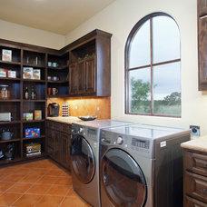 Mediterranean Laundry Room by Bella Villa Design Studio