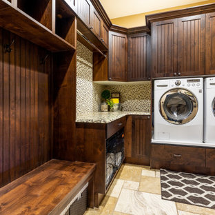 Example of a mountain style travertine floor laundry room design in Other with granite countertops and a side-by-side washer/dryer