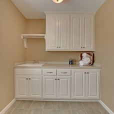 Transitional Laundry Room by Kariel Staging & Decor