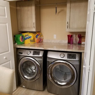 Mid-sized transitional single-wall porcelain tile laundry closet photo in Miami with light wood cabinets, granite countertops, a side-by-side washer/dryer and recessed-panel cabinets
