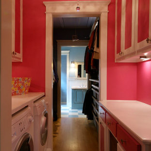 Inspiration for a mid-sized shabby-chic style galley light wood floor dedicated laundry room remodel in Dallas with shaker cabinets, white cabinets, wood countertops, pink walls and a side-by-side washer/dryer