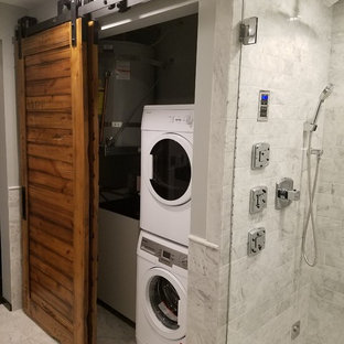 Laundry closet - mid-sized contemporary marble floor laundry closet idea in Portland with gray walls and a stacked washer/dryer