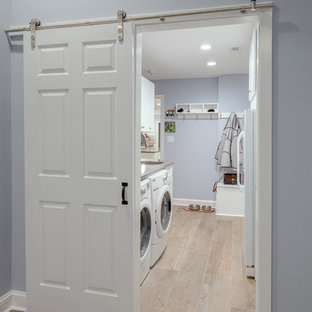 Mid-sized trendy galley porcelain tile utility room photo in Philadelphia with an undermount sink, shaker cabinets, white cabinets, granite countertops and gray walls