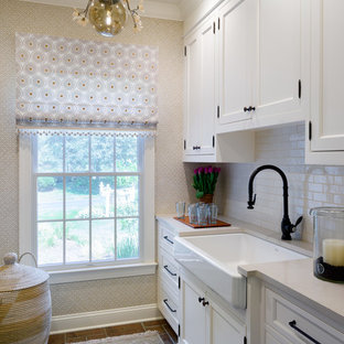 Inspiration for a small transitional porcelain floor laundry room remodel in New York with a farmhouse sink, quartz countertops, beige walls, a side-by-side washer/dryer, beige countertops, recessed-panel cabinets and white cabinets