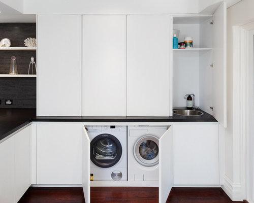 buanderie moderne avec un plan de travail en granite. Black Bedroom Furniture Sets. Home Design Ideas