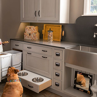 Mid-sized trendy ceramic floor and beige floor utility room photo in Houston with a farmhouse sink, soapstone countertops, beige walls, beaded inset cabinets and gray cabinets