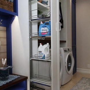 Photo of a large contemporary galley utility room in Orange County with a submerged sink, recessed-panel cabinets, blue cabinets, quartz worktops, beige walls, porcelain flooring, a side by side washer and dryer, beige floors and white worktops.