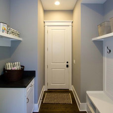 Traditional Laundry Room by plantation building corp