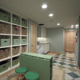Traditional laundry room in Denver with open cabinets.