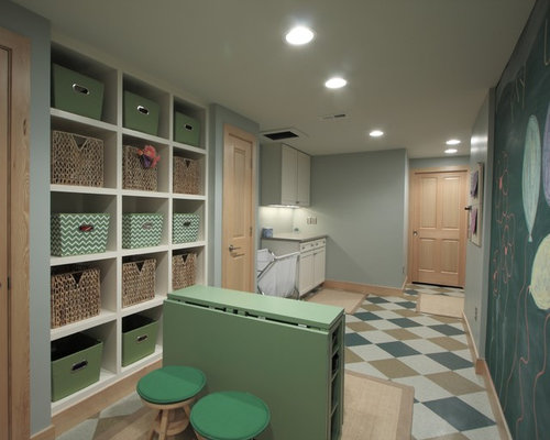 traditional laundry room idea in denver with open cabinets