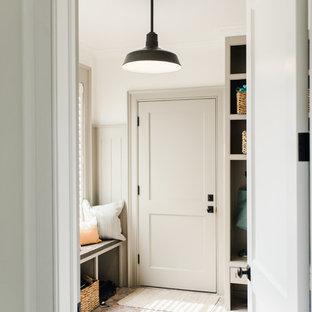 Идея дизайна: прачечная среднего размера в современном стиле с фасадами с утопленной филенкой, белыми фасадами, гранитной столешницей, белыми стенами, кирпичным полом, со стиральной и сушильной машиной рядом и красным полом