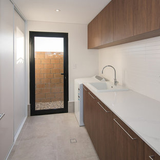 Midcentury laundry room in Other.