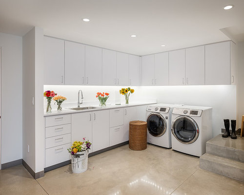 minimalist l shaped laundry room photo in seattle with flat panel