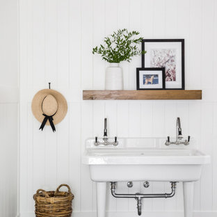 Transitional gray floor and shiplap wall laundry room photo in Vancouver with an utility sink and white walls