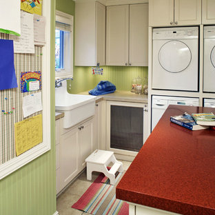Traditional laundry room in Omaha with beige cabinets, beige floor and red benchtop.