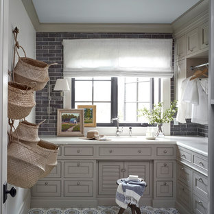 Laundry room - farmhouse l-shaped multicolored floor laundry room idea in Salt Lake City with beaded inset cabinets, gray cabinets, gray walls and white countertops