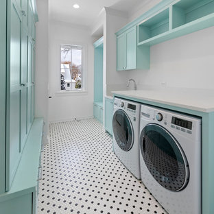 Design ideas for a large country galley dedicated laundry room in Chicago with an undermount sink, flat-panel cabinets, blue cabinets, quartz benchtops, white walls, ceramic floors, a side-by-side washer and dryer, white floor and white benchtop.
