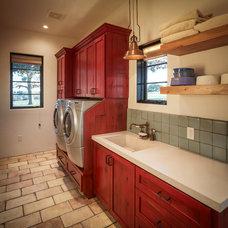 Rustic Laundry Room by Thompson Custom Homes