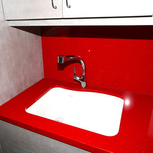Large contemporary galley separated utility room in Los Angeles with a submerged sink, flat-panel cabinets, grey cabinets, quartz worktops, white walls, porcelain flooring and a side by side washer and dryer.