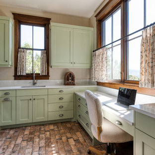 Example of a classic u-shaped brown floor utility room design in Salt Lake City with an undermount sink, shaker cabinets, green cabinets, beige walls, a side-by-side washer/dryer and white countertops