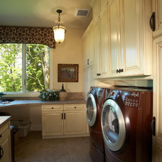 Traditional Laundry Room by Stackman Custom Homes Inc.